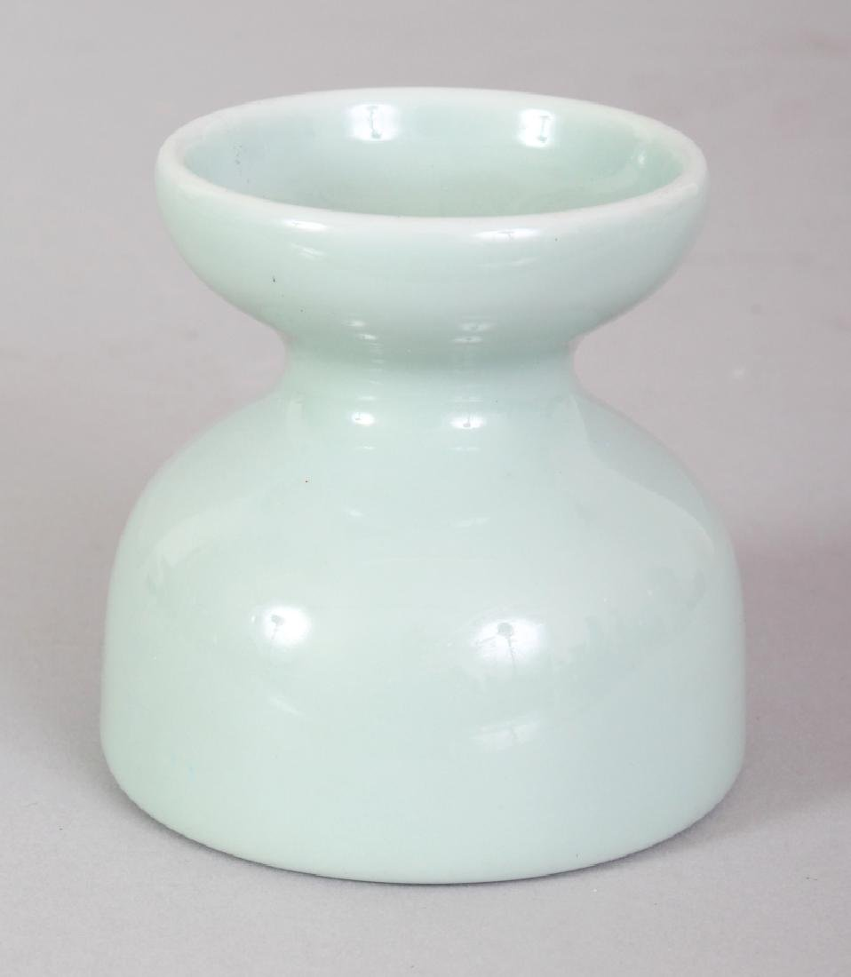 A CHINESE CELADON WAISTED PORCELAIN WATER POT, the base