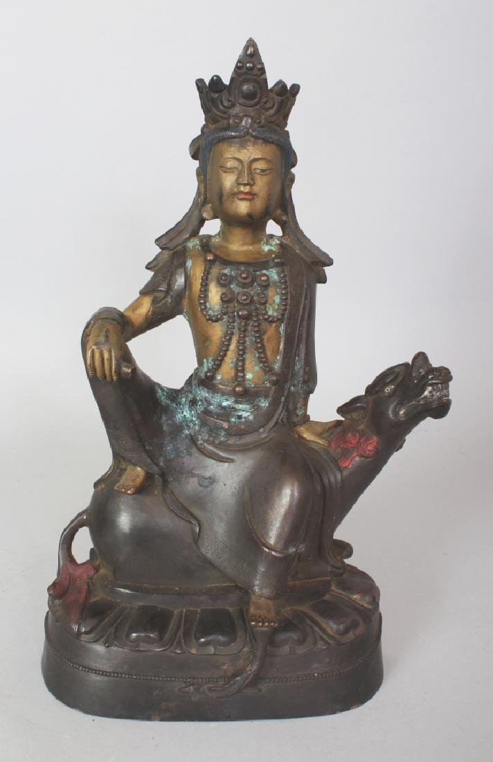 A SINO-TIBETAN GILT BRONZE FIGURE OF GUANYIN, seated on