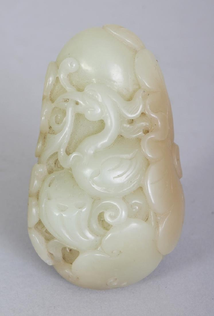 A CHINESE CELADON JADE PEBBLE CARVING, decorated with a
