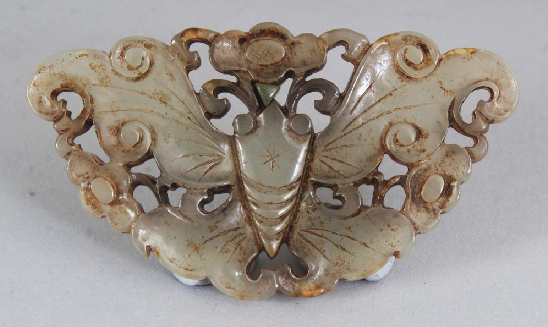 A CHINESE PIERCED JADE BUTTERFLY PENDANT, the stone of