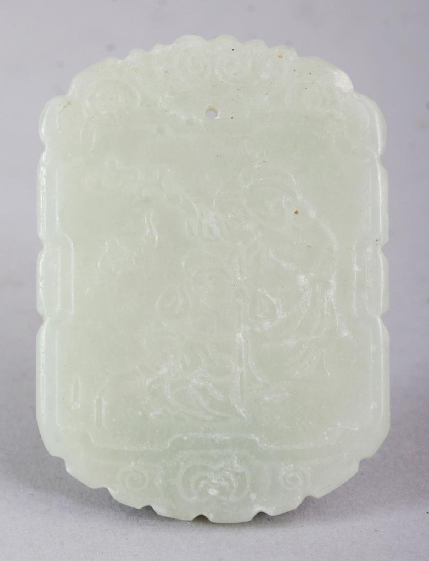 A CHINESE CELADON JADE PENDANT, decorated with a