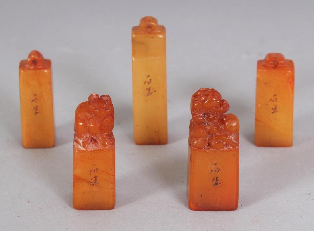 A SET OF FIVE SMALL CHINESE STONE SEALS, contained in a