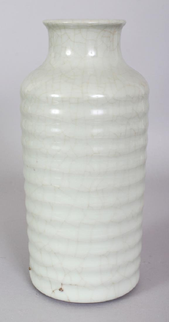 A CHINESE CELADON PORCELAIN VASE, of cylindrical form