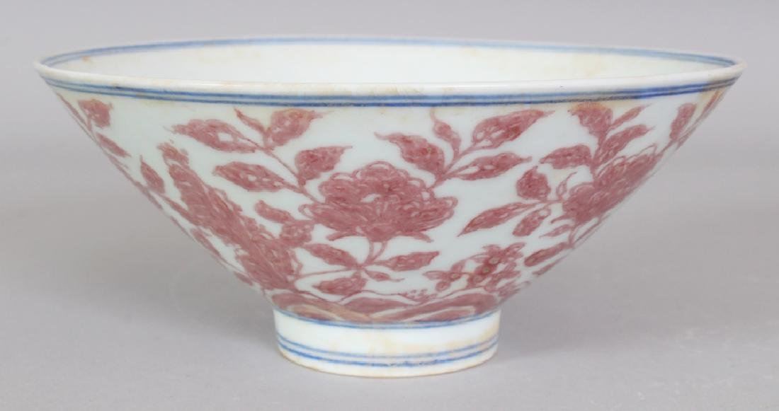 A CHINESE MING STYLE UNDERGLAZE COPPER RED CONICAL