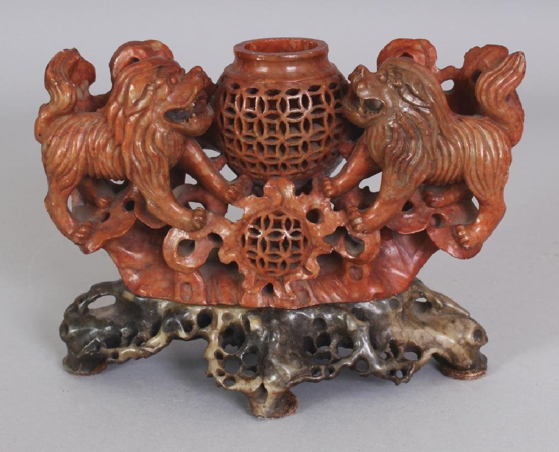 A 20TH CENTURY CHINESE RUSSET SOAPSTONE VASE, on a