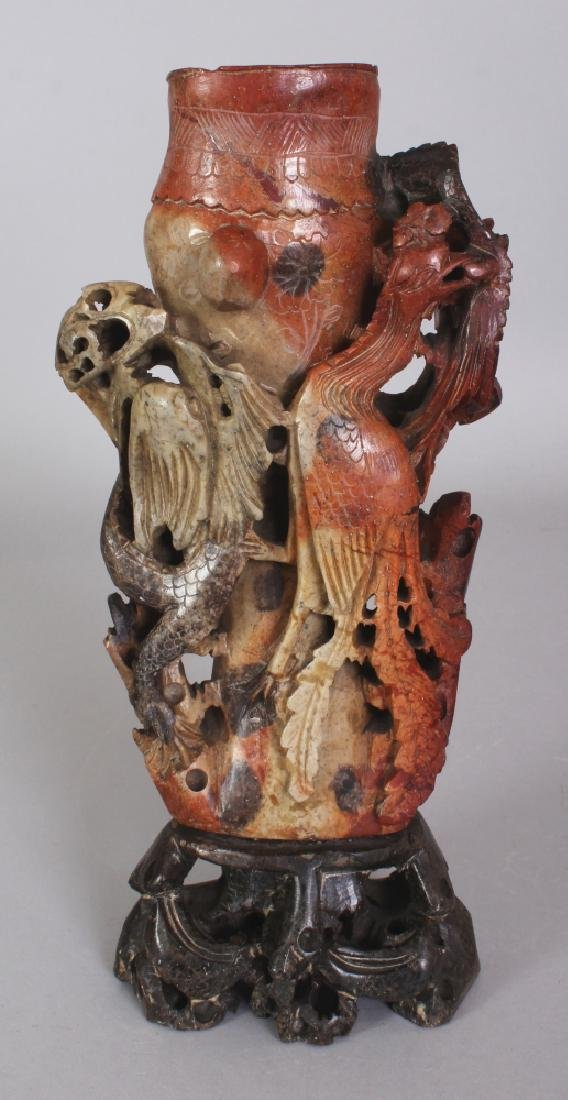 A 20TH CENTURY CHINESE SOAPSTONE DRAGON & PHOENIX VASE,