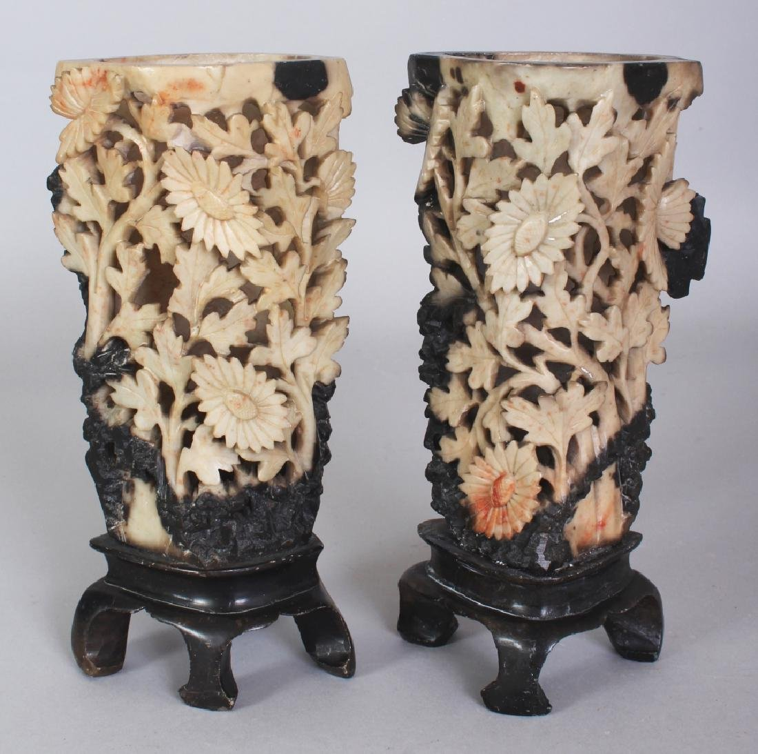 A PAIR OF 20TH CENTURY CHINESE PIERCED FLORAL SOAPSTONE