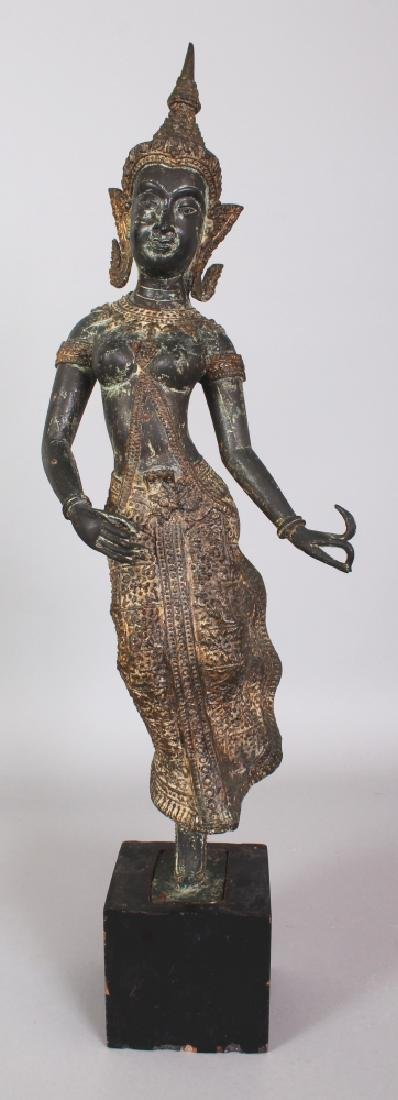A 20TH CENTURY THAI GILT BRONZE THEPHANOM FIGURE OF A