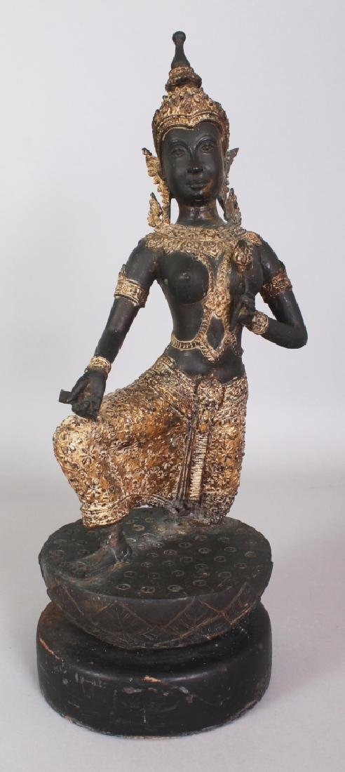 A 20TH CENTURY THAI GILT BRONZE OF A KNEELING THEPHANOM