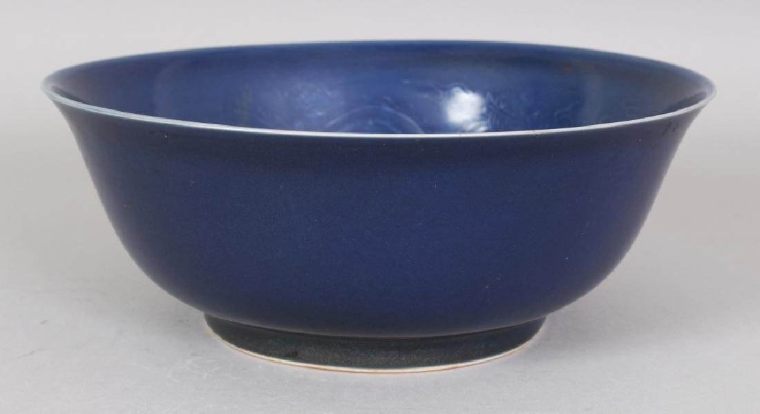 A CHINESE MING STYLE BLUE GLAZED PORCELAIN BOWL, the