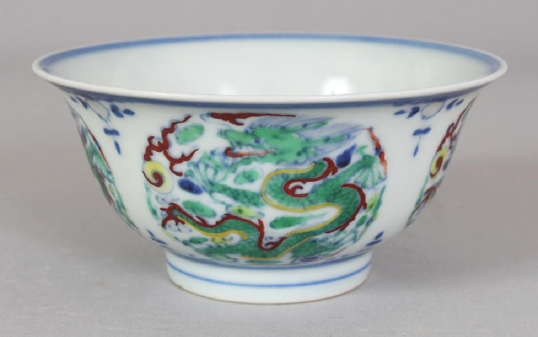A SMALL CHINESE DOUCAI PORCELAIN DRAGON BOWL, the base