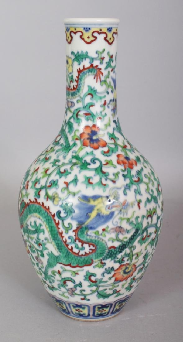 A CHINESE DOUCAI PORCELAIN BOTTLE VASE, the sides