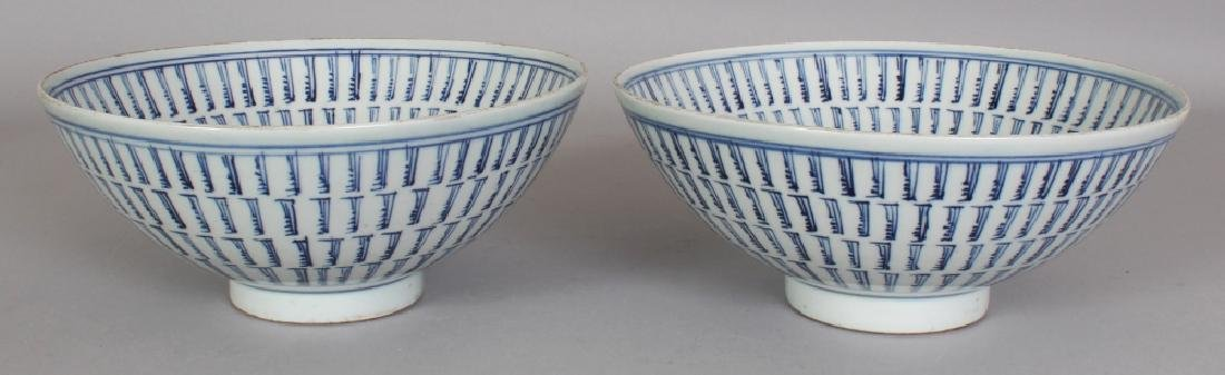 A NEAR PAIR OF CHINESE BLUE & WHITE PROVINCIAL STYLE