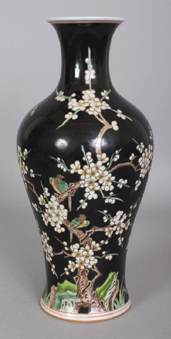 A CHINESE FAMILLE NOIRE BALUSTER PORCELAIN VASE, the