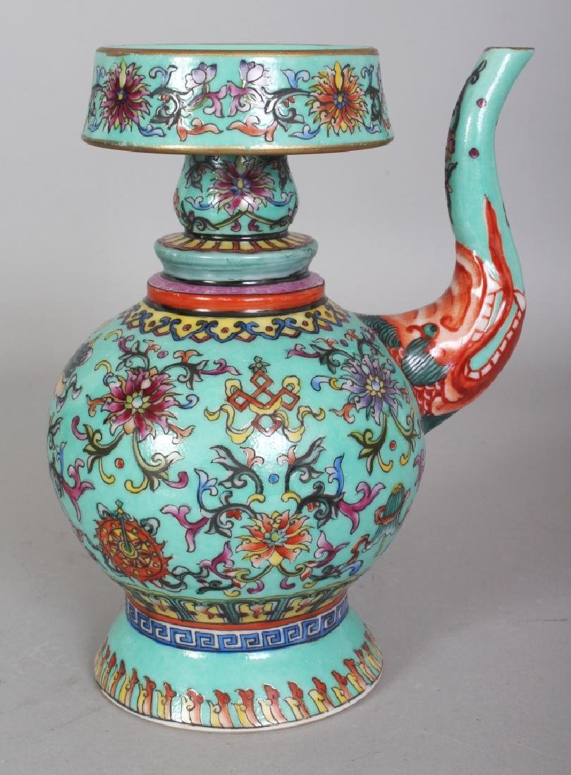 A CHINESE TIBETAN MARKET TURQUOISE GROUND FAMILLE ROSE