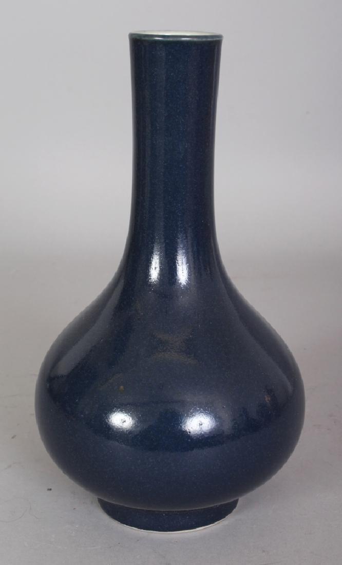 A CHINESE BLUE GLAZED PORCELAIN BOTTLE VASE, the base