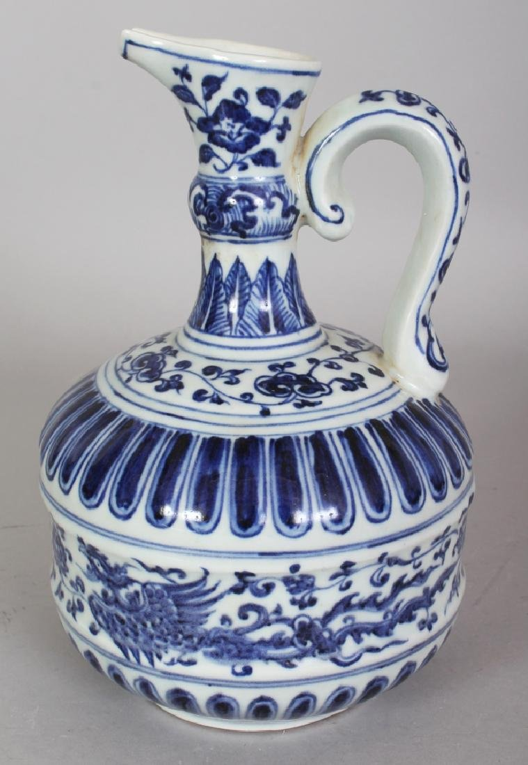 A CHINESE MING STYLE BLUE & WHITE PORCELAIN PHOENIX