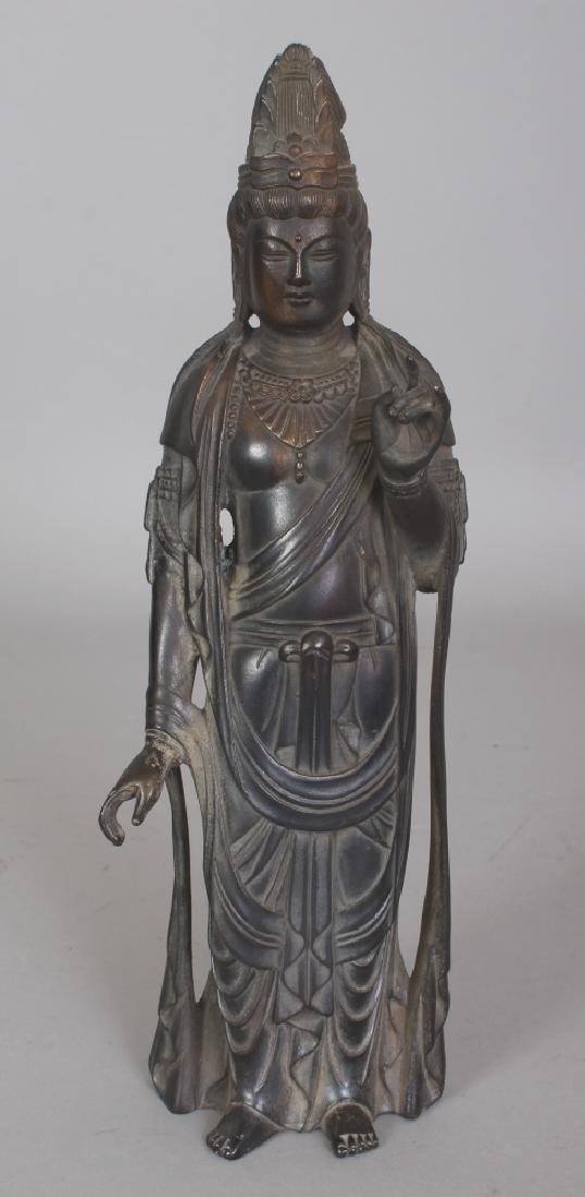 A CHINESE BRONZE FIGURE OF A STANDING GUANYIN, 11in