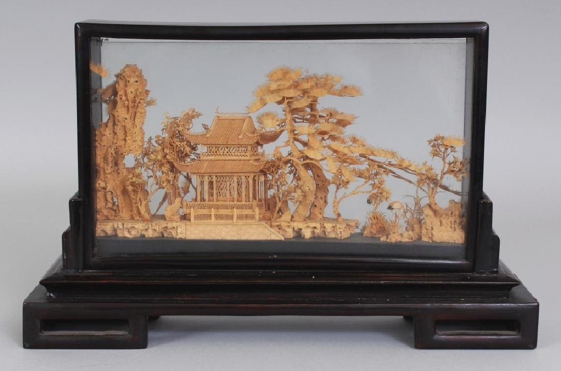 A 20TH CENTURY CHINESE CORK CARVING, in a wood and
