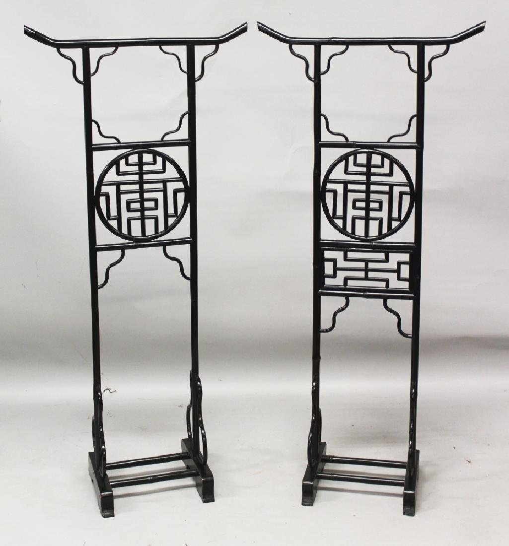 A PAIR OF ORIENTAL LACQUERED WOOD COSTUME STANDS, each