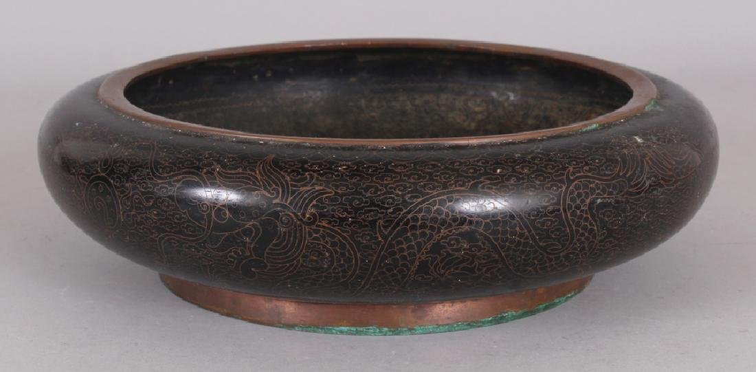 AN EARLY/MID 20TH CENTURY CHINESE BLACK GROUND SHALLOW