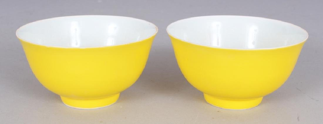A PAIR OF CHINESE MING STYLE YELLOW GLAZED PORCELAIN