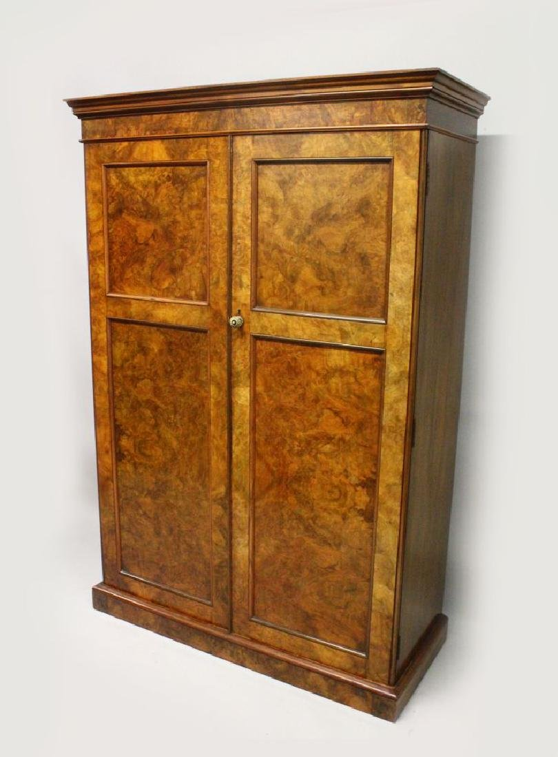 A VICTORIAN FIGURED WALNUT WARDROBE, with a moulded