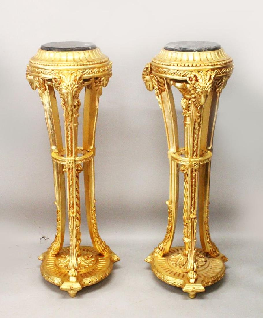 A PAIR OF GILT WOOD TORCHERES, with marble tops and