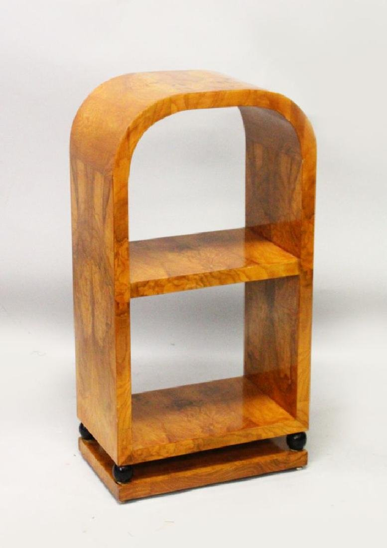 AN ART DECO STYLE BURR WOOD OPEN BOOKCASE. with curving