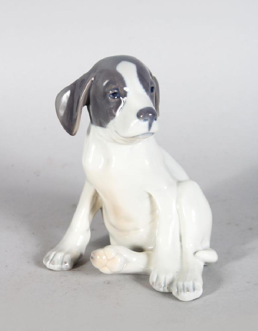 A ROYAL COPENHAGEN SEATED PUPPY No: 206