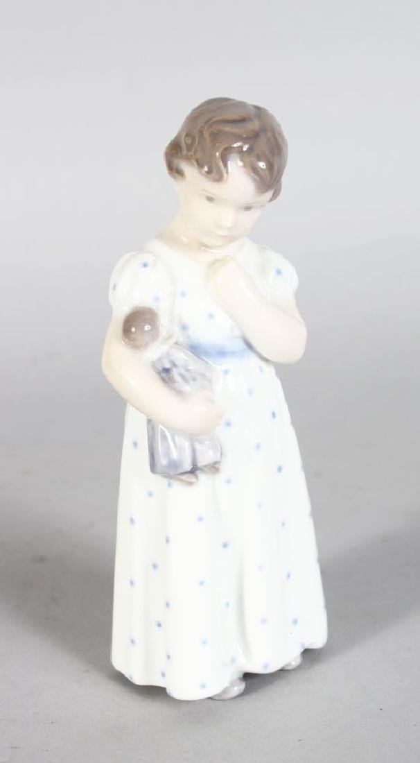A ROYAL COPENHAGEN FIGURE OF A YOUNG GIRL WITH A DOLL