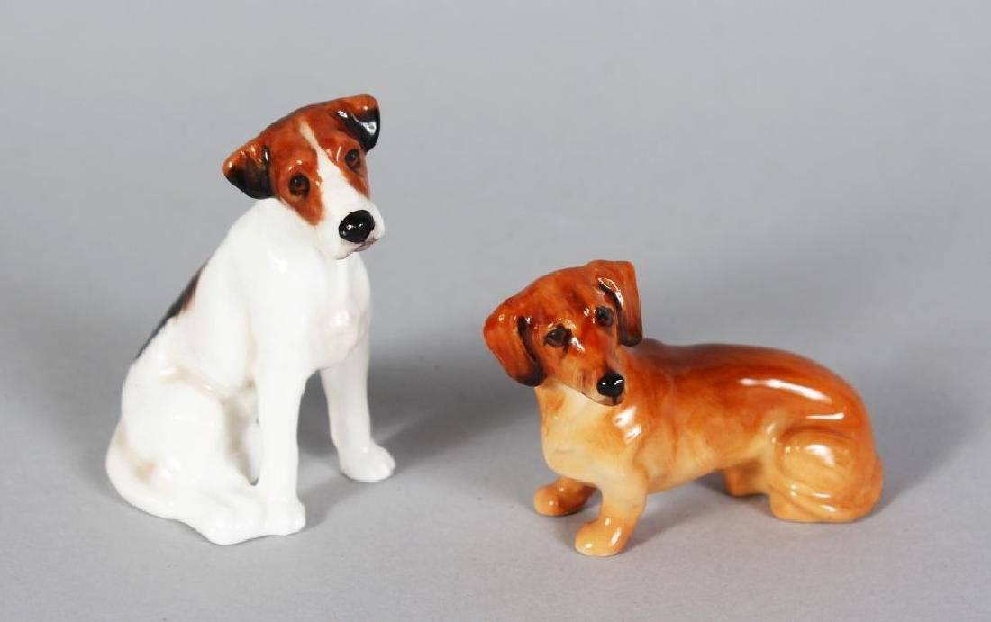 TWO SMALL ROYAL DOULTON DOGS K17 AND no number.  2.5in