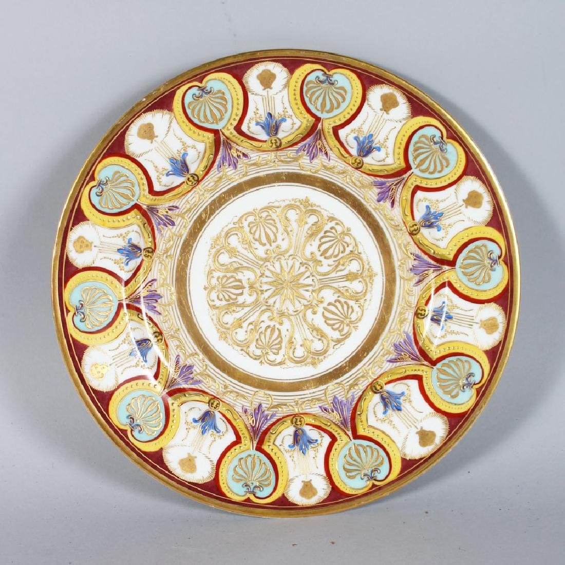 A SEVRES PORCELAIN CIRCULAR PLATE, the border with gold