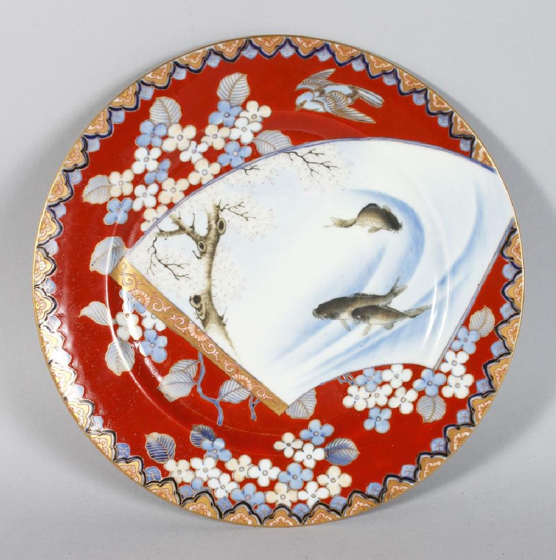 A JAPANESE PORCELAIN CIRCULAR PLATE, painted with carp