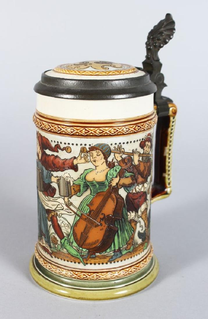 A GOOD METTLACH POTTERY TANKARD, etched with a band of
