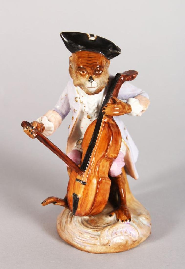 A CONTINENTAL PORCELAIN MONKEY FIGURE PLAYING A CELLO
