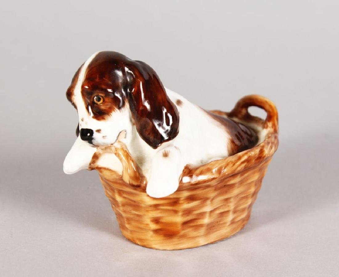 A ROYAL DOULTON COCKER SPANIEL, in a basket, H.N.2586