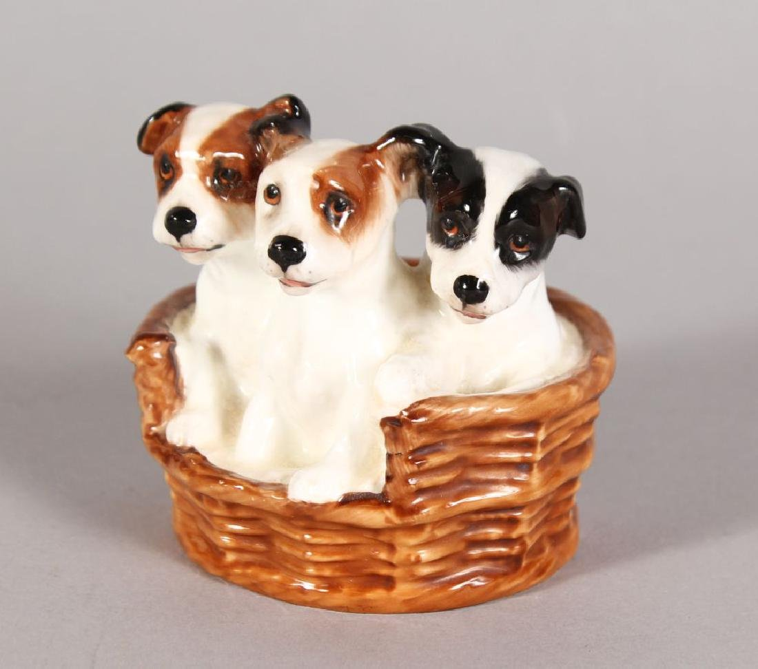 A ROYAL DOULTON GROUP OF THREE TERRIER PUPPIES, in a
