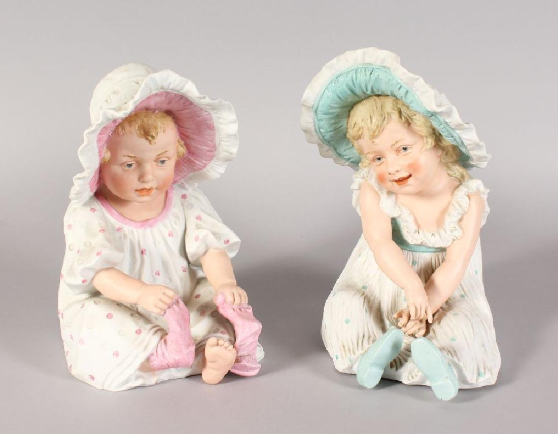 A LARGE PAIR OF VICTORIAN CONTINENTAL BISQUE SEATED