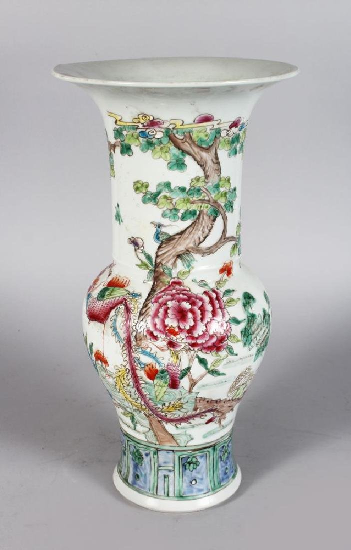 A CHINESE FAMILLE ROSE BALUSTER SHAPED VASE, decorated