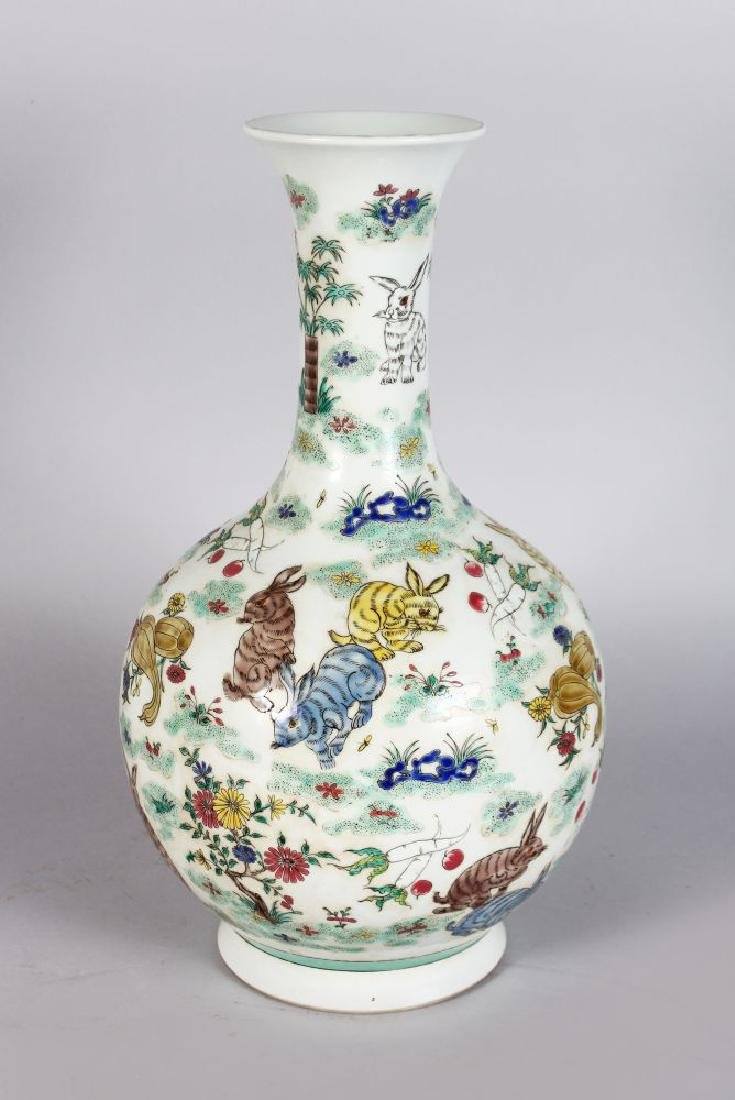 A CHINESE BULBOUS SHAPED VASE, decorated with rabbits