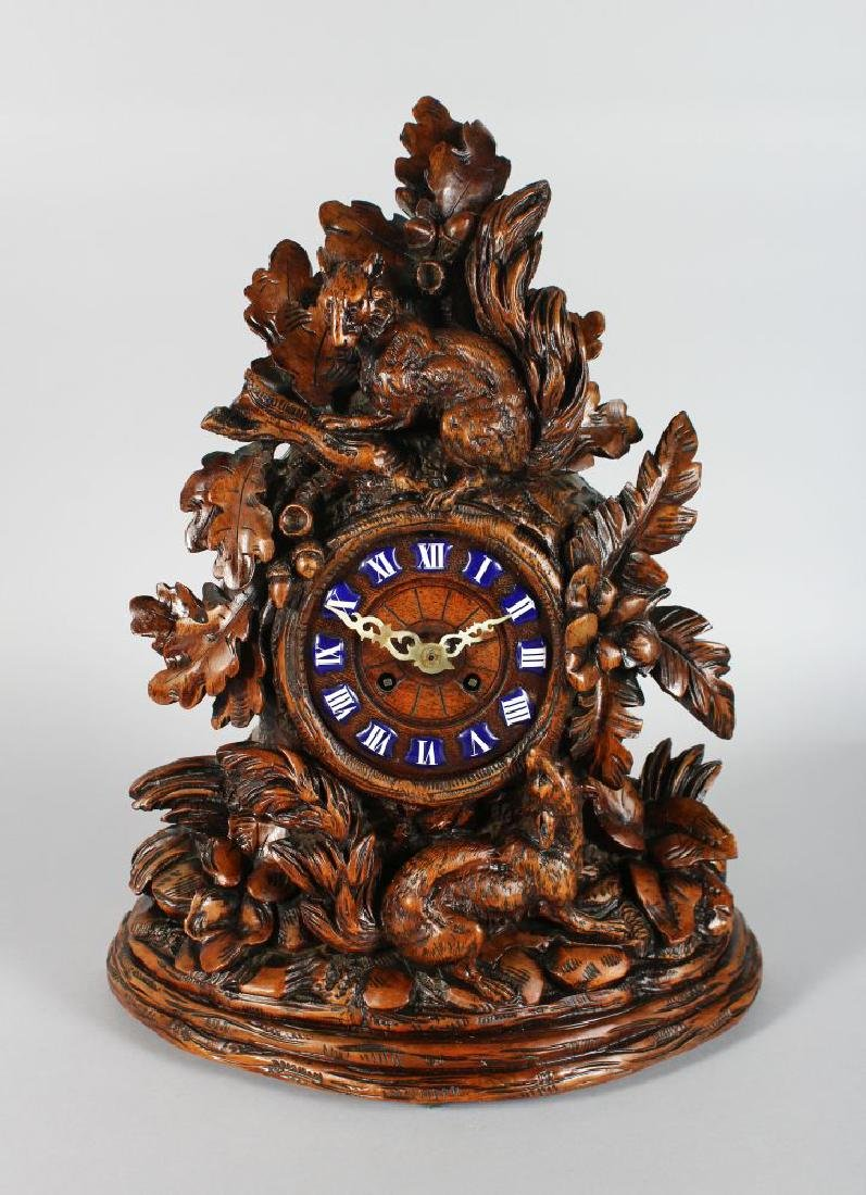 A GOOD 19TH CENTURY BLACK FOREST CARVED WOOD CLOCK,