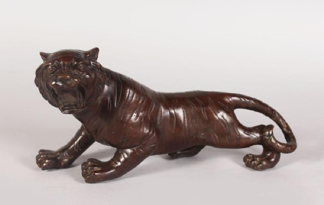 A BRONZE PROWLING TIGER 1ft 1in long