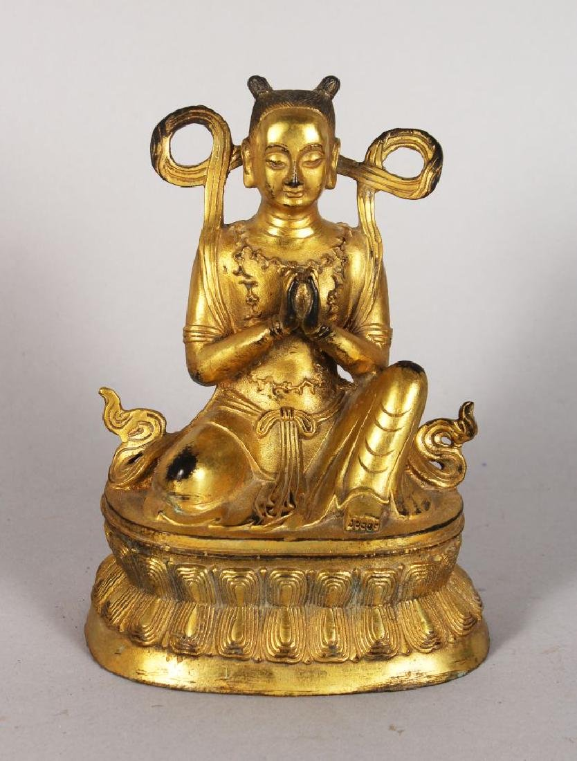 A GOOD GILDED BRONZE BUDDHA, hands clasped on a lotus