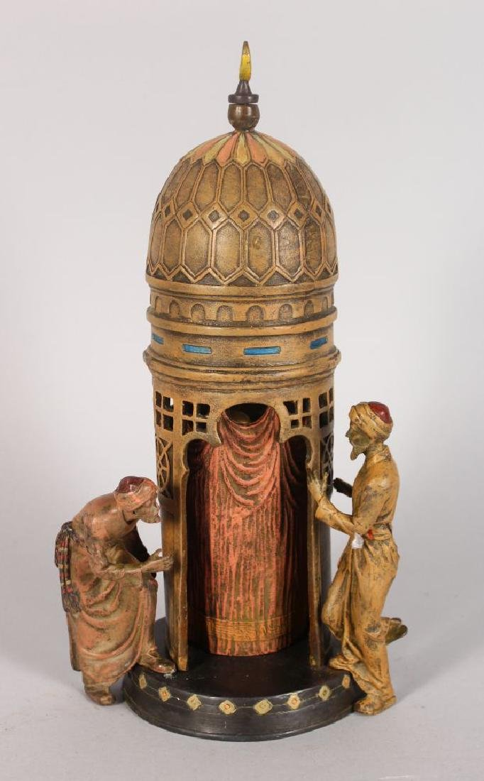 A COLD PAINTED BRONZE GROUP, depicting an Arab temple