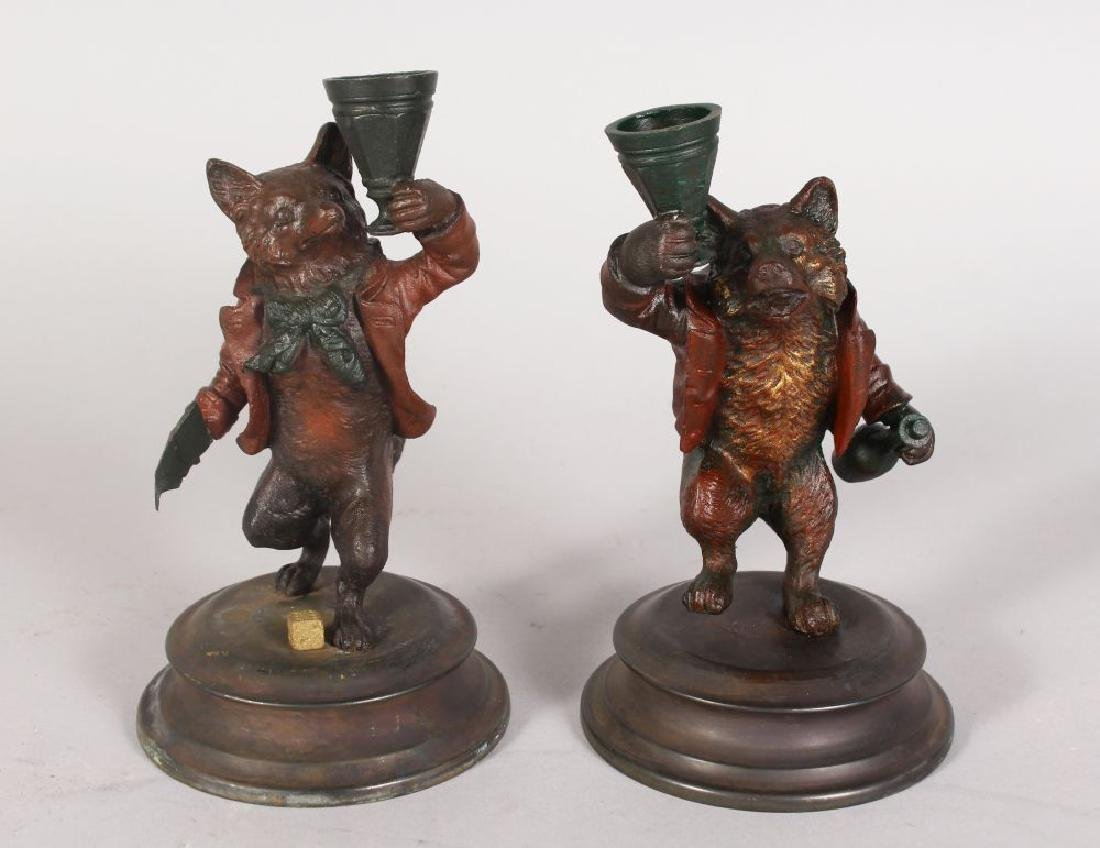 A PAIR OF SMALL COLD PAINTED BRONZE CANDLESTICKS,