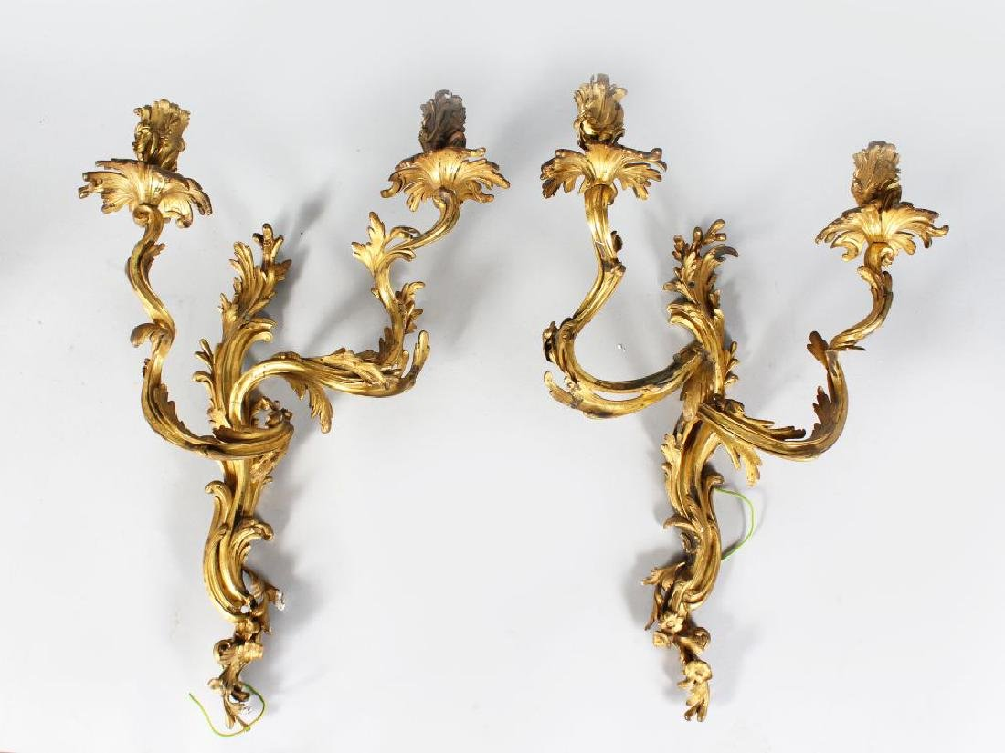 A PAIR OF GILT BRONZE LOUIS XV WALL LIGHTS  23in high