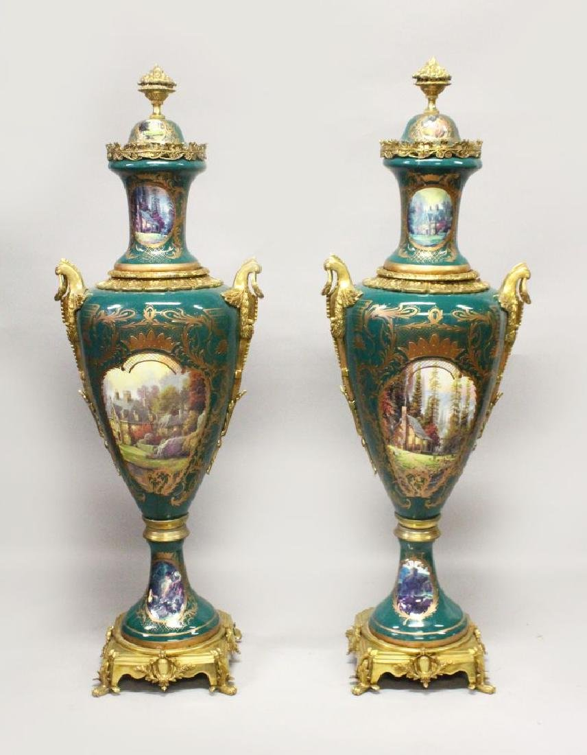 AN IMPOSING PAIR OF SEVRES STYLE PORCELAIN AND ORMOLU