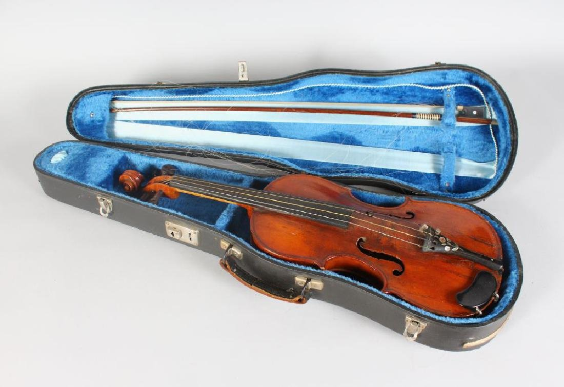 """A MID 19TH CENTURY VIOLIN, bears label """"repaired by"""