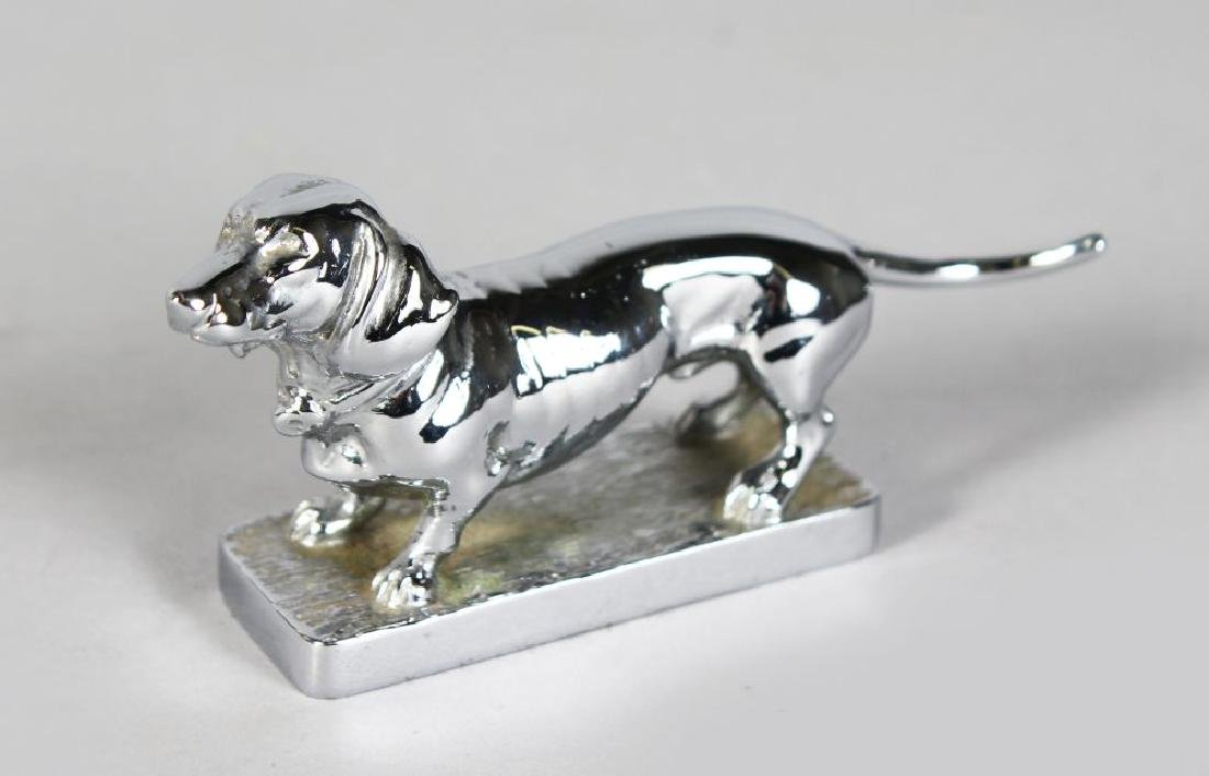 A DACHSHUND CAR MASCOT, 4in long.